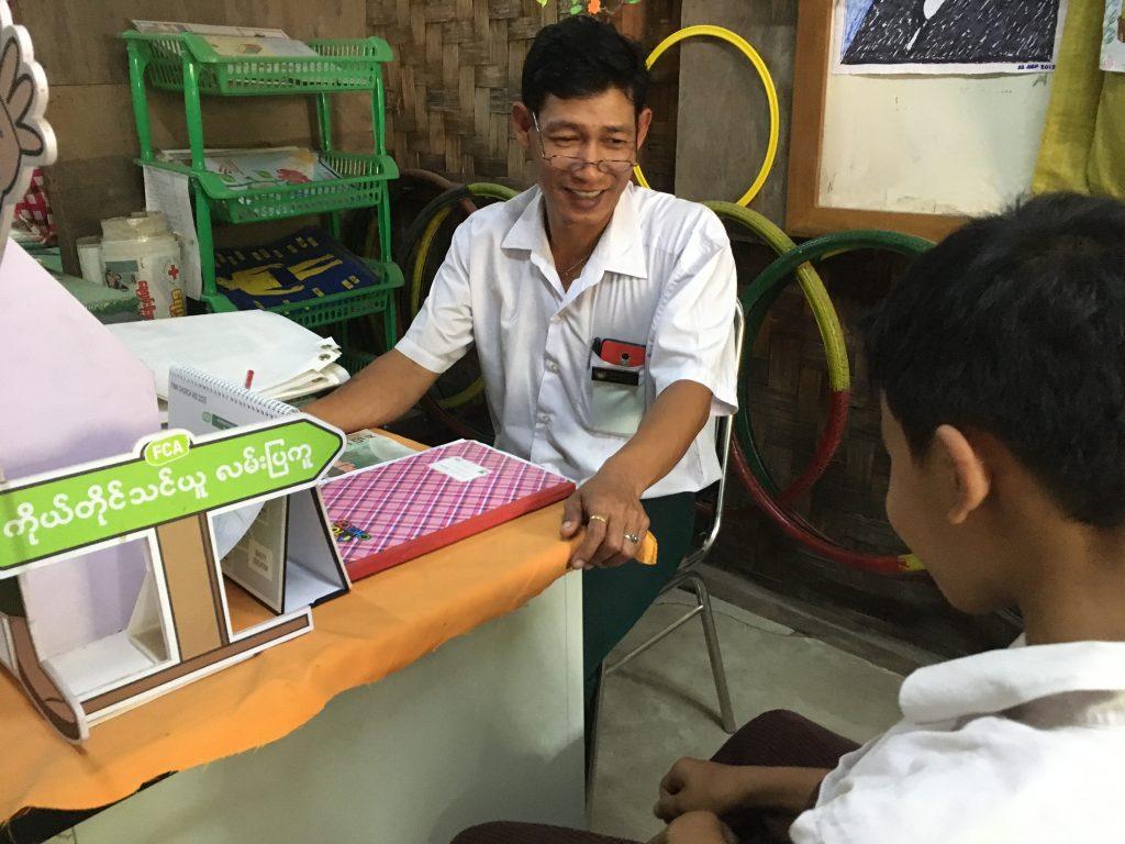Councellor guiding a student